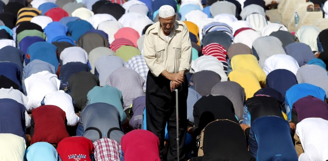 Palestinian men take part in Friday prayers in the Arab east Jerusalem neighbourhood of Ras al-Amud, outside the Old City